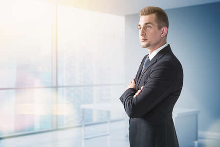 Photo for Confident businessman in suit in panoramic office - Royalty Free Image