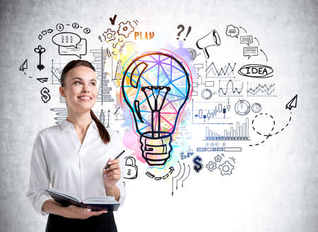 Foto de Office woman with pencil and business notes near lightbulb sketch with circuit of network connection, graphs and financial analysis. Concept of business idea and management - Imagen libre de derechos