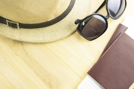 Travel accessories costumes.Passport, glasses, on a wooden. top view, Travel concept.