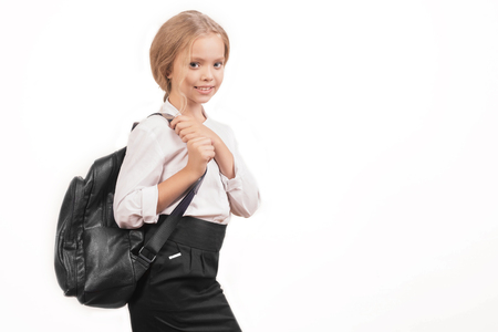 Foto de portrait of a smiling schoolgirl in uniform with school backpack - Image - Imagen libre de derechos