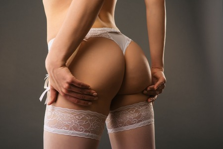 Photo pour Sexy female booty closeup in white belt panties and lace stockings - image - image libre de droit
