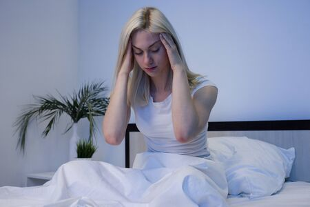Photo pour Depressed woman awake in the night, she is exhausted and suffering from insomnia - Image - image libre de droit