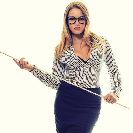 Foto de Sexy girl with glasses Strict teacher a long black skirt and striped shirt with a pointer in his hand isolated on white - Imagen libre de derechos