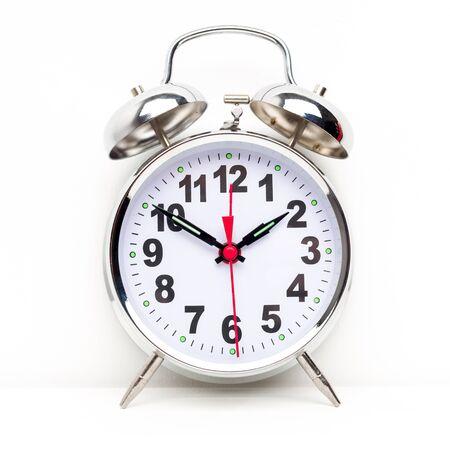 Foto de Metal retro alarm clock on white background - image - Imagen libre de derechos