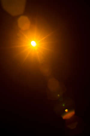 Photo for Abstract Natural Sun flare on the black. - Royalty Free Image