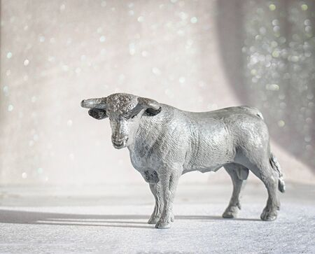 Photo for Bull symbol of the year 2021. Year of the white metal bull according to the Chinese calendar on a sparkling silver pastel background - Royalty Free Image