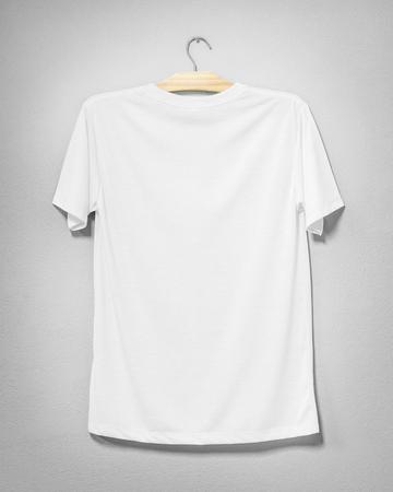 Photo pour White shirt hanging on cement wall. Empty clothing for design. Back view. - image libre de droit
