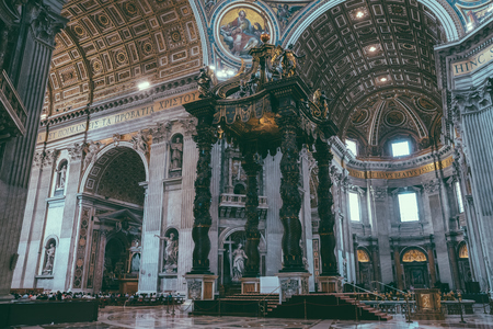 Rome, Italy - June 22, 2018: Panoramic view of interior of Papal Basilica of St. Peter (St. Peter's Basilica). It is an Italian Renaissance church in Vatican City, papal enclave within city of Rome