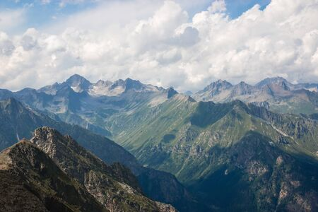 Photo for Panorama of mountains scene with dramatic cloudy sky in national park of Dombay, Caucasus, Russia. Summer landscape and sunny day - Royalty Free Image