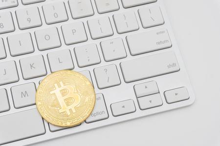 Golden Bitcoins on keyboard. Selective focus.
