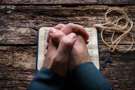 Photo pour man praying on the Bible selective focus - image libre de droit
