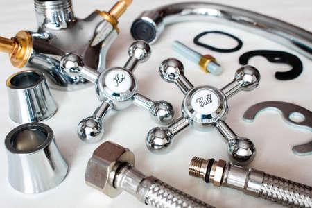 Photo pour plumbing tools. details of a kitchen faucet on a white background - image libre de droit