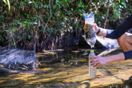 Photo pour Simple natural water filtering gear use for outdoor camping. - image libre de droit