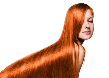 portrait of a beautiful woman with long red healthy shiny straight hair , isolated on white
