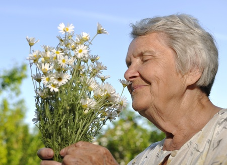Happy older woman with flowers.