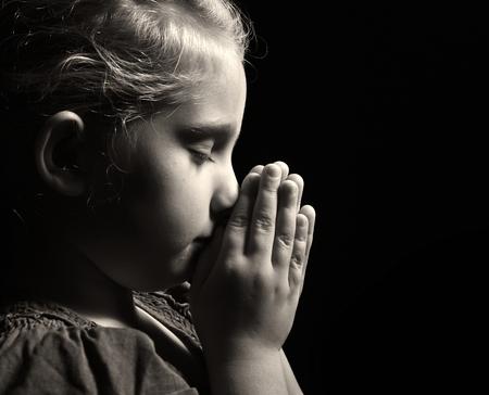 Photo for Praying child. - Royalty Free Image