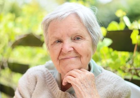 Photo for Senior happy woman smiling in garden. - Royalty Free Image