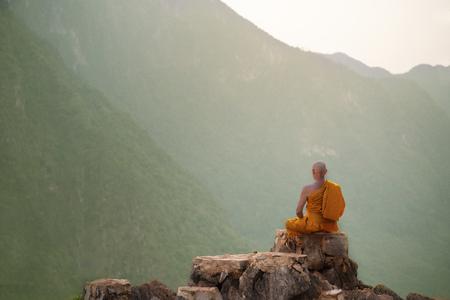 Photo pour Buddha monk practice meditation on mountain - image libre de droit