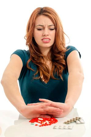 Photo pour Patient saying no to medical treatment. Beautiful woman refuse to take pills. - image libre de droit