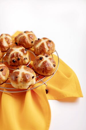 Photo for Buns marked with a cross and containing dried fruit, traditionally eaten during Lent. - Royalty Free Image