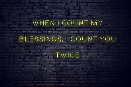 Photo pour Positive inspiring quote on neon sign against brick wall when i count my blessings i count you twice. - image libre de droit