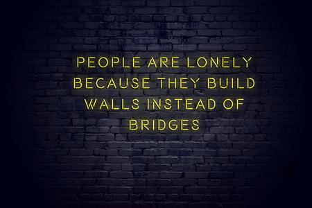 Photo pour Neon sign with positive wise motivational quote against brick wall . - image libre de droit