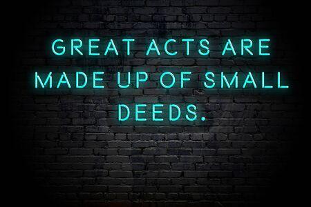 Foto de Neon inscription of positive wise motivational quote against brick wall . - Imagen libre de derechos