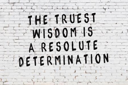 Photo pour White brick wall with painted black motivational quote inscription. - image libre de droit