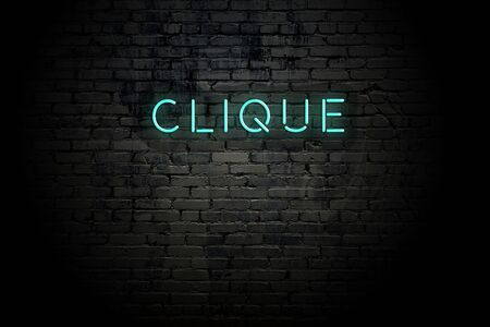 Highlighted brick wall with neon inscription clique.