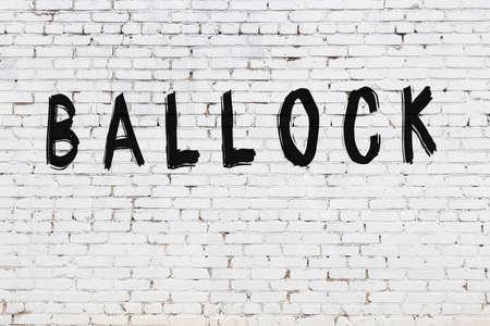 Photo pour White brick wall with inscription ballock handwritten with black paint - image libre de droit