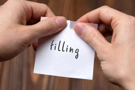 Photo for Cancelling filling. Hands tearing of a paper with handwritten inscription. - Royalty Free Image