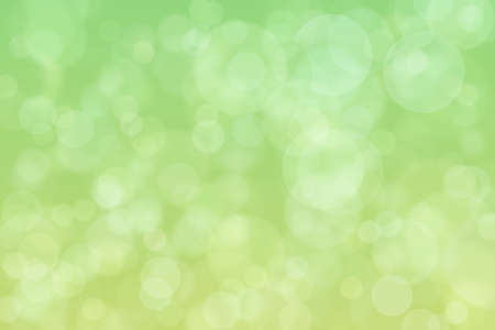Foto de Light spots on green background. Abstract bokeh. - Imagen libre de derechos