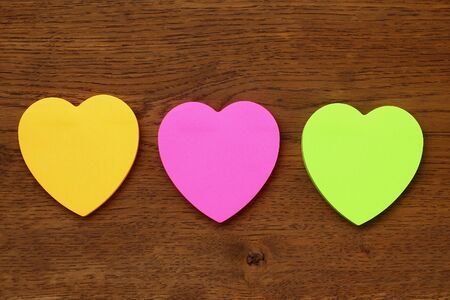 Photo pour Three blank heart shaped stickers with space for text. Creative symbolic background on the theme of love - image libre de droit
