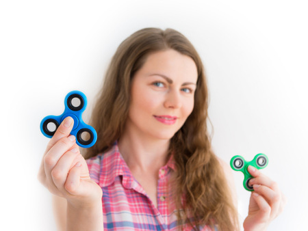 Girl holding a colourful hand fidget spinner toy