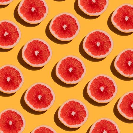 Foto für Grapefruit pattern on yellow background. Minimal flat lay concept. - Lizenzfreies Bild