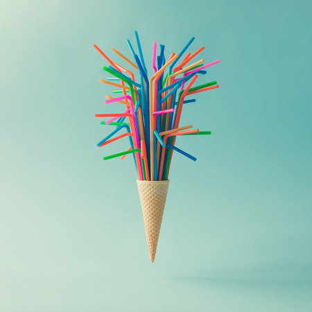 Photo for Ice cream cone with colorful drinking straws on bright blue background. Minimal food concept. - Royalty Free Image