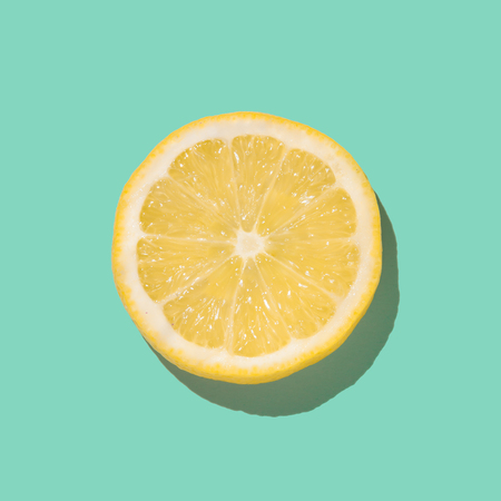 Foto per Fresh lemon slice close up on bright blue background. Flat lay. Summer concept. - Immagine Royalty Free