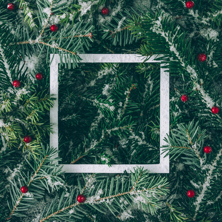Photo pour Creative layout made of Christmas tree branches with snow and paper card note. Flat lay. Nature New Year concept. - image libre de droit