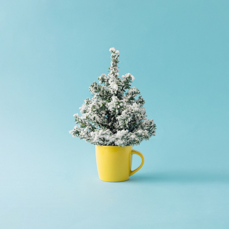 Coffee cup with Christmas tree. Minimal winter holidays concept.