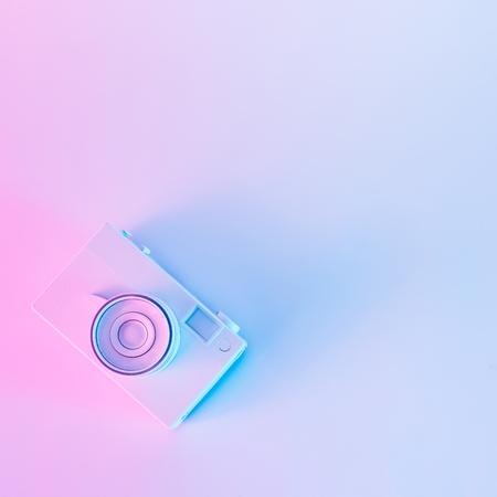 Foto de Vintage camera in vibrant bold gradient purple and blue holographic colors. Concept art. Minimal summer surrealism. - Imagen libre de derechos