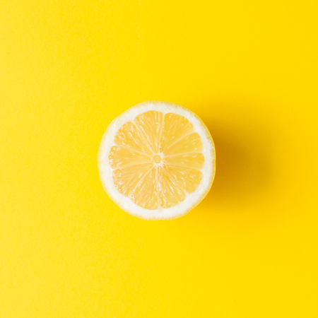 Foto de Lemon on vivid yellow background. Minimal summer concept. Flat lay. - Imagen libre de derechos
