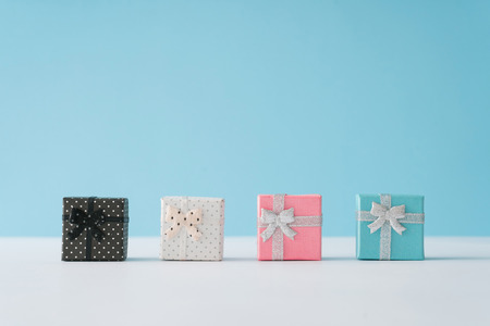 Foto de Colorful gift boxes on pastel blue background. Minimal Christmas or New Year concept. - Imagen libre de derechos