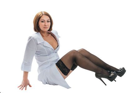 Photo for Sexually doctor woman on isolated white background. Caucasian woman medic with beautiful sexy pantyhose, bra and panties. The girl has a big syringe with a red liquid. - Royalty Free Image