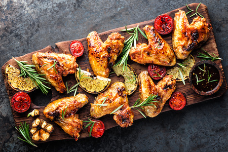 Foto für appetizing chicken wings grilled barbecue with spices and vegetables until crisp - Lizenzfreies Bild