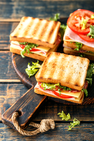 Photo for sandwiches with grilled toast ham salami cheese tomatoes and lettuce - Royalty Free Image