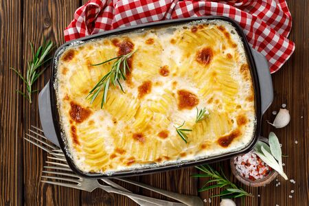 Photo for Potato gratin. Baked potato with cream, cheese and garlic - Royalty Free Image