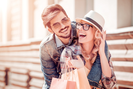 Photo for Portrait of a couple with shopping bags. - Royalty Free Image