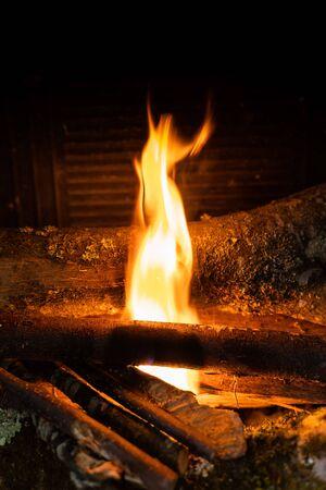 Photo pour Starting up a fire with wooden sticks inside a chimney - image libre de droit