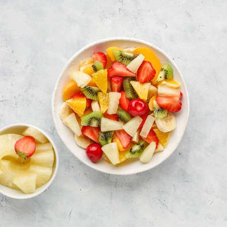 Fresh chopped fruit salad in a bowl.