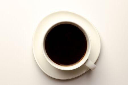 Photo pour Top view of a cup of coffee, isolate on white - image libre de droit